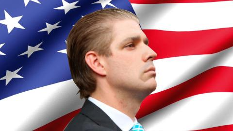 "An image of Frederic ""Fredo"" Trump's head, facing right, set against an American flag background.  Fredo's likeness is Donald Trump Junior's face edited onto Eric Trump's head."